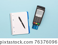 Payment terminal, credit card on blue background 76376096