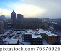 Architecture of modern city, skyline and blue sky and cold snow front with clouds 76376926