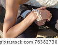 Just married couple hands, bride's and groom's hands with black and white gold diamond wedding rings 76382730
