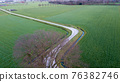 Rural Road Through Countryside. Rows of Farmfields. Summer Landscape. Aerial Drone View. 76382746
