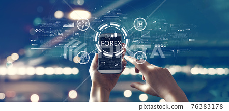 Forex trading concept with person using smartphone 76383178
