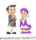 The girl and boy are using the muslim outfit and giving the greeting 76385777