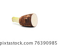 Taro root cut in half on white isolated background with clipping path 76390985