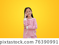 Asian little child girl thinking gesture isolated on yellow background with clipping path 76390991
