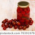 Marinated tomatoes in jar, with ingredients 76391976