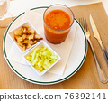 Glass of gazpacho with cucumber and croutons 76392141