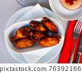 Tasty crispy grilled chicken wings on plate 76392166