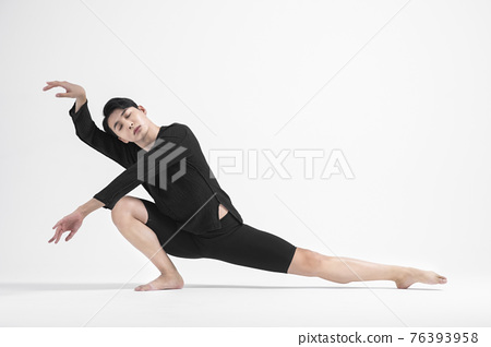 contemporary asian male dancer making move in white background 76393958