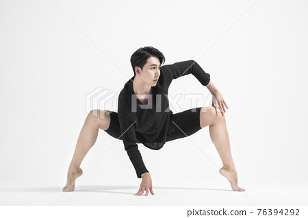 contemporary asian male dancer making move in white background 76394292