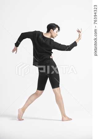 contemporary asian male dancer making move in white background 76394323
