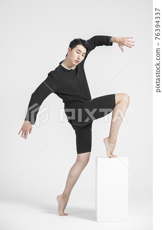contemporary asian male dancer making move in white background 76394337