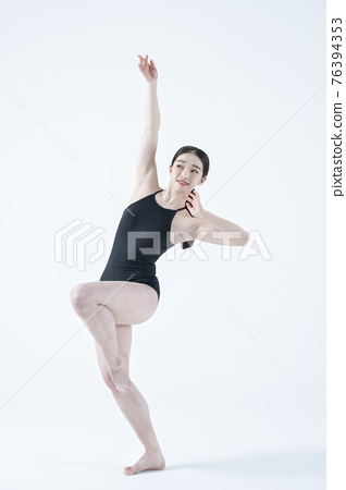 contemporary Asian female dancer making move in white background 76394353