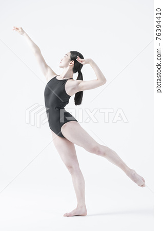 contemporary Asian female dancer making move in white background 76394410