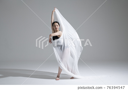 male and female couple modern contemporary dancers making moves in white background setting 76394547