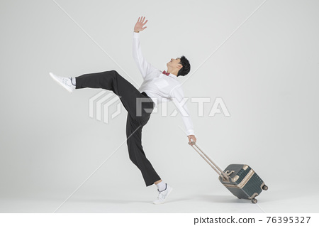 Asian male contemporary dancer with travel bag 76395327