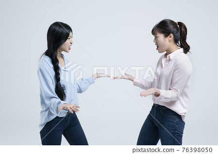 Asian sisters, women fighting concept, white background 76398050