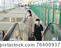 Asian couple on escalator with face masks 76400937