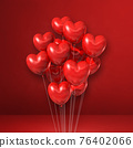 Heart shape balloons bunch on a red wall background 76402066