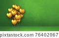 Gold heart shape balloons bunch on a green wall background. Horizontal banner. 76402067
