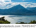 Aerial view of the Lake Garda and Italian Alps - Mountain Peak of Monte Pizzocolo 76405447