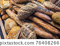 different types of bread. Wholegrain, round, rolls and loaves, with seeds and cereals 76408266
