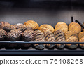 many different types of bread. Wholegrain, round, rolls and loaves 76408268