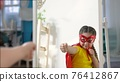 girl superhero portrait face. feminism a happy family a close-up home kid dream winner concept. child superhero in mask. beautiful kid girl superhero. child play hero. business leader concept 76412867