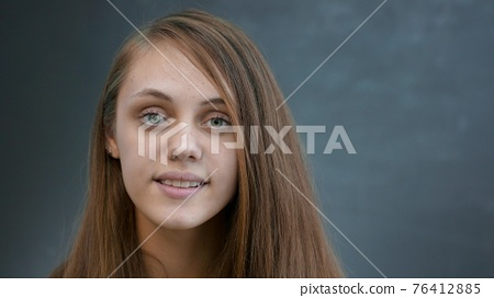 face girl a close-up. portrait lifestyle of a teenager girl smiling beautiful eyes blonde at home indoors. face of a girl teenager student. smiling man beautiful female student 76412885