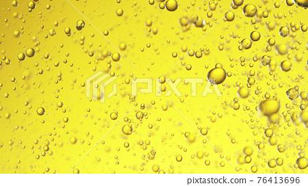 Close up of golden oil bubbles 76413696