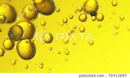 Close up of golden oil bubbles 76413697