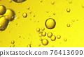 Close up of golden oil bubbles 76413699