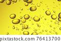 Close up of golden oil bubbles 76413700