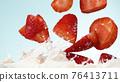 Strawberries falling into milk 76413711