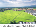 Land plot and green field in aerial view. 76414041