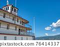 Upper decks of steam vessel on blue sky background 76414337