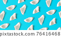 Coconut pieces pattern on blue background, from above 76416468