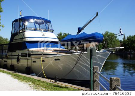 Boat Docked On Shore 76416653