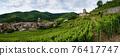 Vineyards and panoramic view of Keysersberg, winemaking village in Alsace (france) 76417747