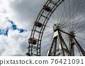 Ferris wheel in an amusement park.Blue sky. Copy space 76421091