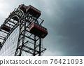 Ferris wheel in an amusement park.Blue sky. Copy space 76421093