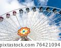Ferris wheel in an amusement park.Blue sky 76421094