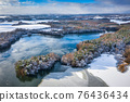 Aerial landscape of the frozen lake in Poland at winter 76436434