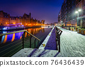 Snowy scenery of Gdansk over Motlawa river at dawn, Poland. 76436439