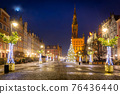 Christmas tree and decorations in the old town of Gdansk at dawn, Poland 76436440