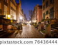 Christmas decorations in the old town of Gdansk at night, Poland 76436444