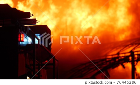 fire truck and flasher fire engine. fire on the roof of the house. a burning at building night house. home apartment insurance concept. huge fire blazes houses 911. property damage arson protection 76445286