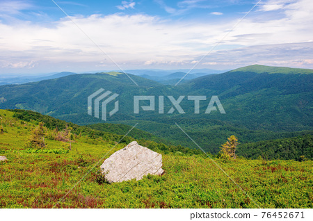 carpathian summer mountain landscape. beautiful countryside with rock on the grassy hill. view in to the distant valley. clouds on the blue sky 76452671