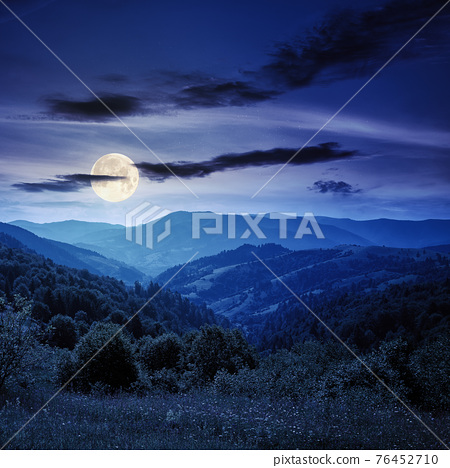 countryside landscape in summer at night. beautiful nature scenery with meadows on the hills rolling in to the distant valley in full moon light 76452710
