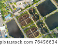 Aerial view High angle view Top down drone shot of the sewage treatment plant.The Solid contact clarifier tank type sludge recirculation in water treatment plant. Industrial wastewater treatment plant 76456634