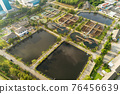 Aerial view High angle view Top down drone shot of the sewage treatment plant.The Solid contact clarifier tank type sludge recirculation in water treatment plant. Industrial wastewater treatment plant 76456639
